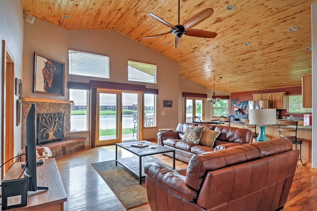 The open-concept floor plan features large windows and beautiful wood accents.