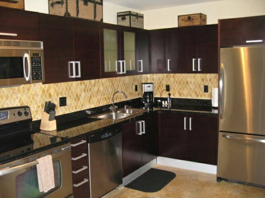 Kitchen area with Granite countertops