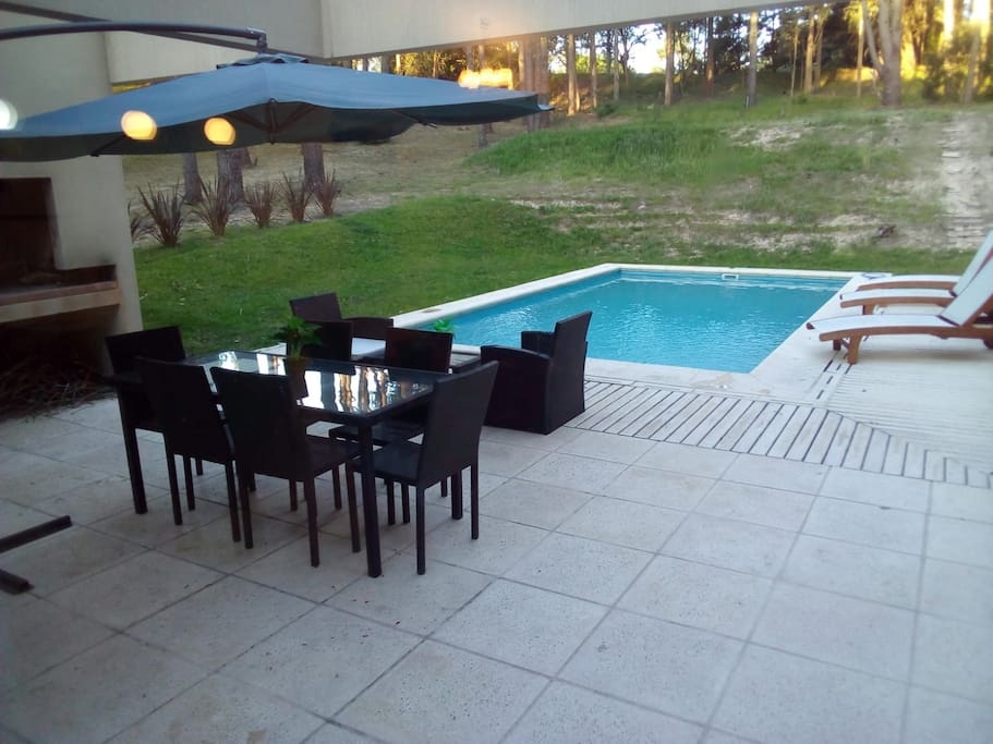 View from sliding door out to pool & barbeque