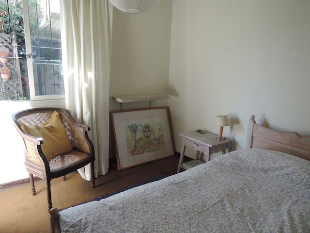 Acogedora habitación con baño privado