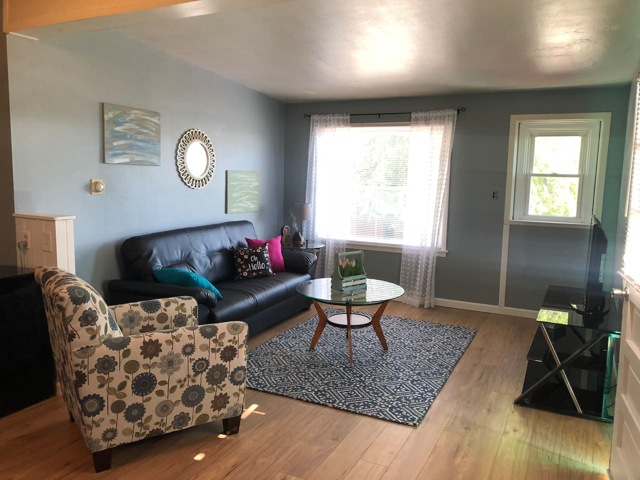 The living area. Perfect for relaxing, kicking back and watching a movie, or playing some board games provided by us!