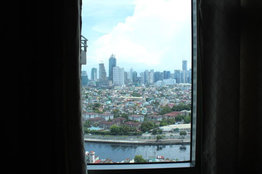 Bonifacio Global City View at the window