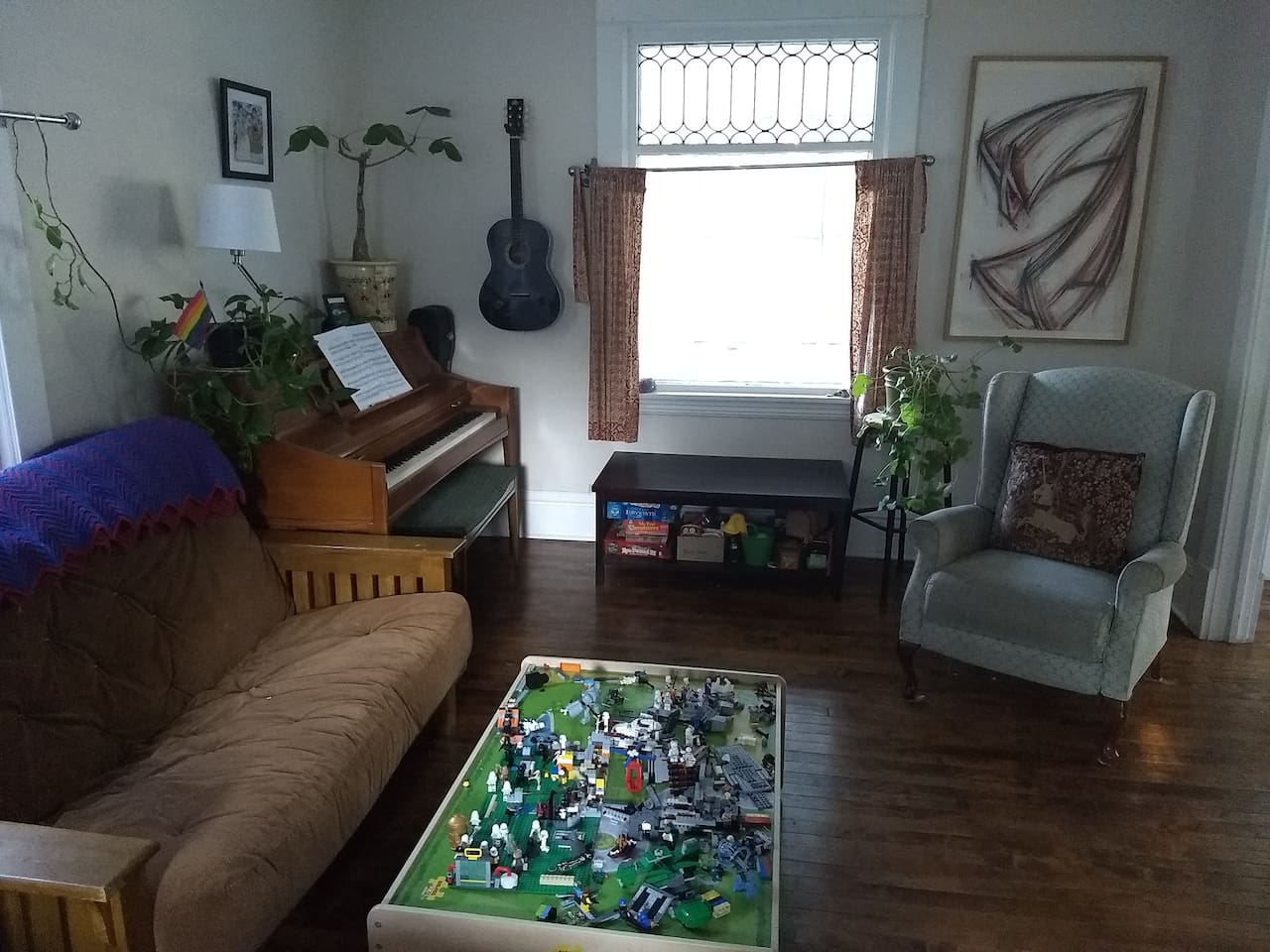 Bright living room with piano and futon