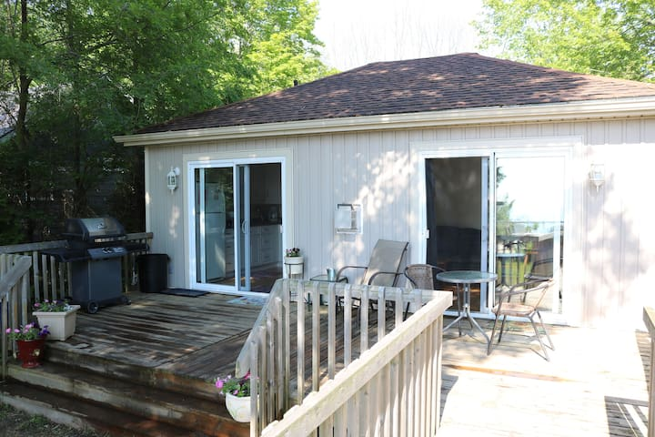 View of the cottage from the back yard - wheel chair accessible deck and cottage