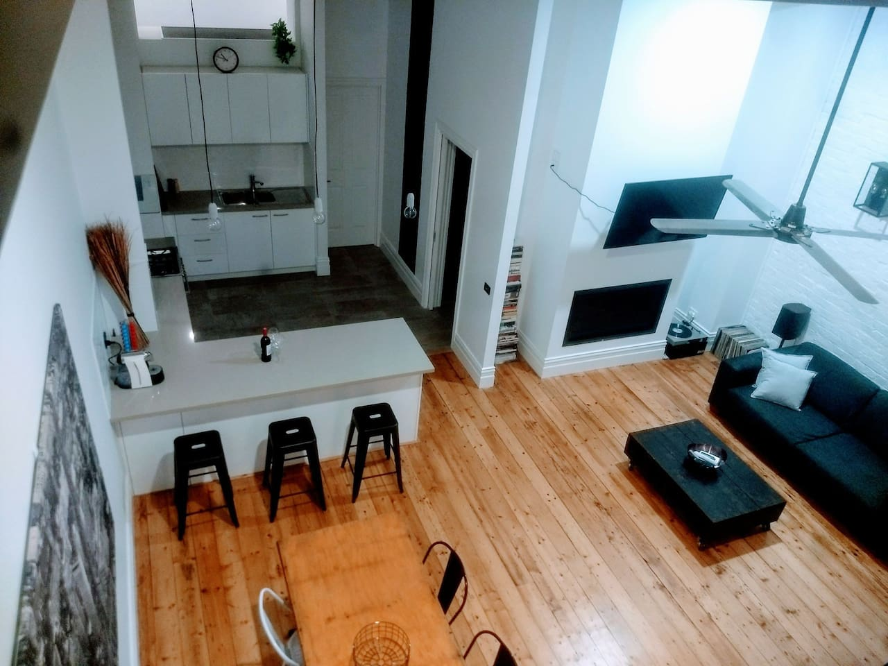 A Birds Eye from the loft of the living, dining and kitchen areas. A great space to enjoy the apartment from!