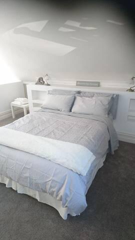 Mezzanine bedroom. Serene quite restful space.