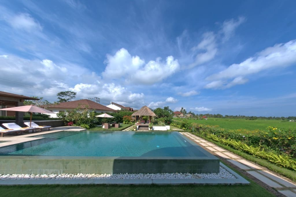 Private pool with rice field view