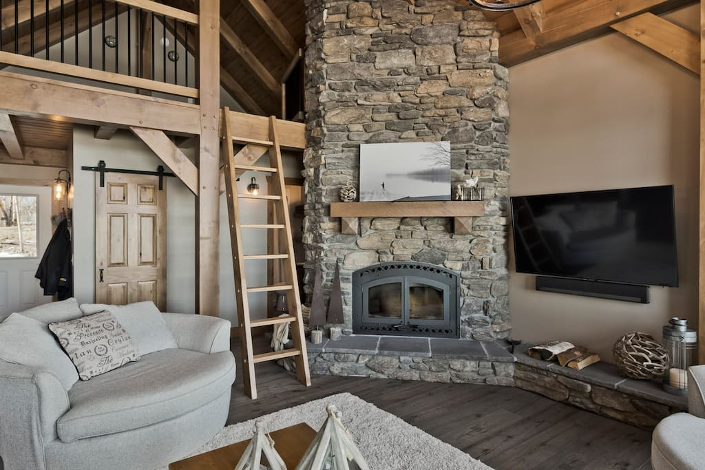 Wood burning fireplace and ladder to loft