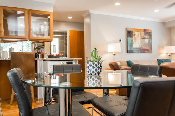 An open flow concept allows easy transitions among living room, dining area and kitchen.
