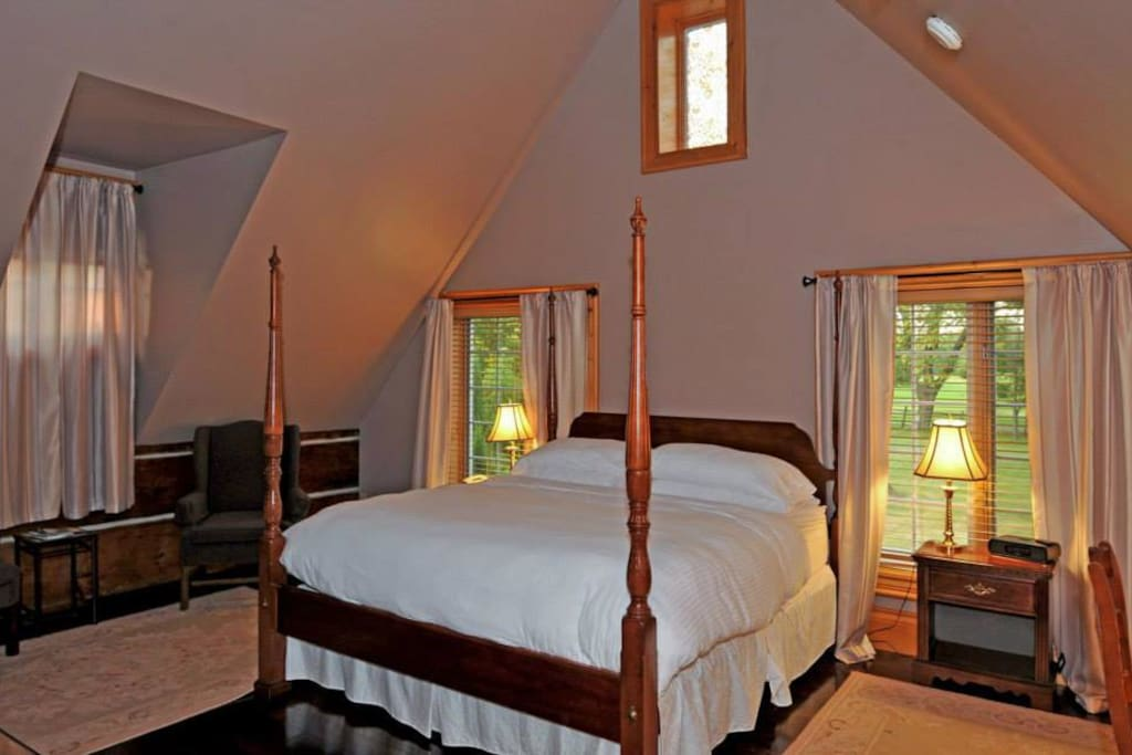 One of the suites, featuring a king bed and vaulted cielings.