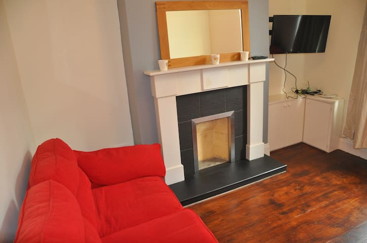 Bright and relaxing living room with TV