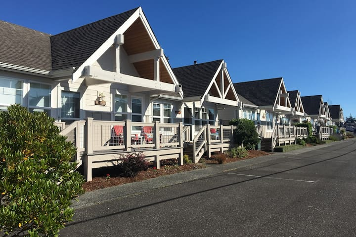 Row of eight cottages.