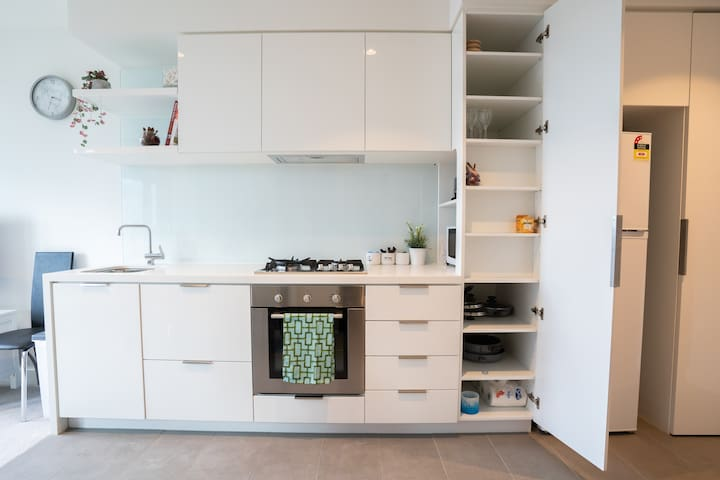 Full kitchen with 4 gas stoves