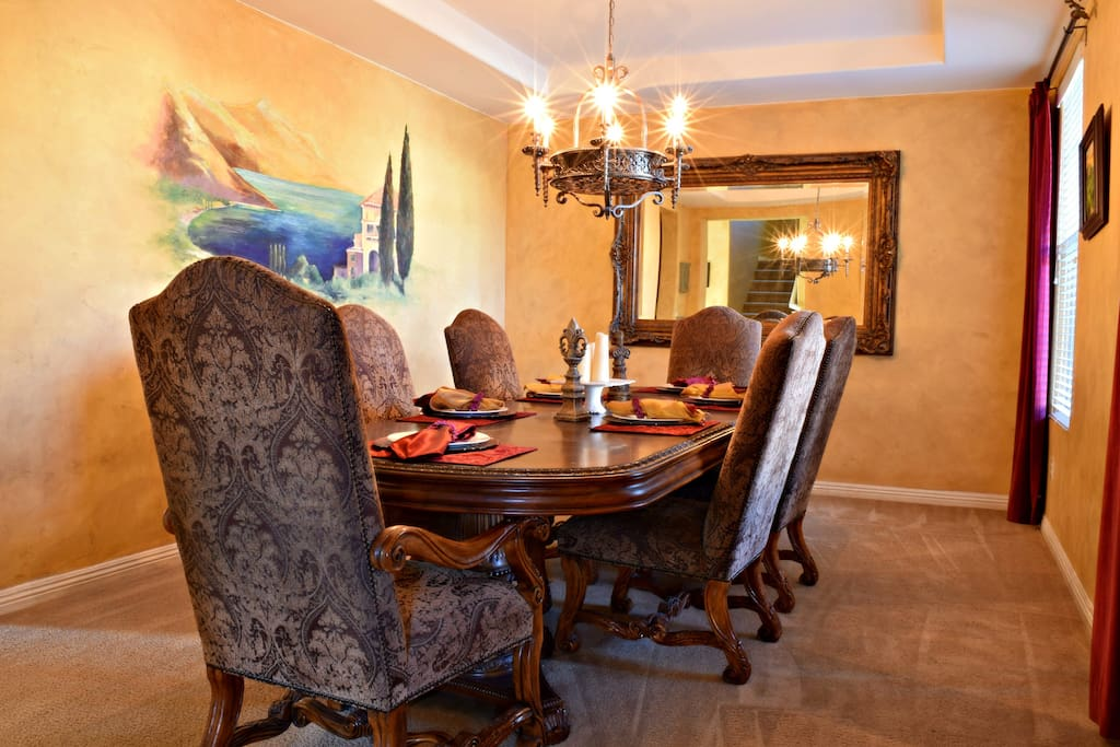 View of the Formal Dining room with a table that seats 10 guest comfortably.