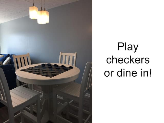 Play checkers at our custom designed table.