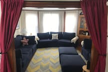 The furniture in this room changes frequently.  There is currently a full sized bed in here, and one of these blue couches (Aug 2019).  This is where Parlor guests would stay.  Curtains give limited privacy at night.
