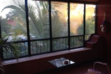 """""""Erin's place is delightful! The room is so large, with a whole separate section to chill in where the sun streams in through the palm fronds whilst you daydream in the hammock."""" --Sarah"""