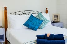 The Kurrimine Fishing Haven is all about relaxing family time spent at the beach.     Fall asleep in the comfy queen bed in the main bedroom to the sounds of the waves lapping the shore.  Nanna naps allowed!