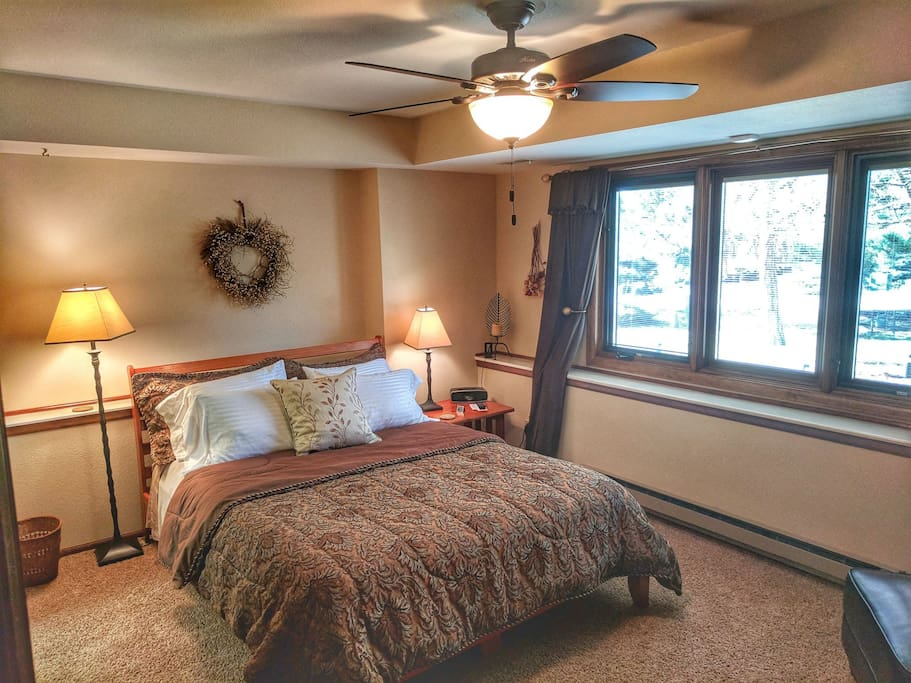 Spacious bedroom with very comfortable queen size bed.