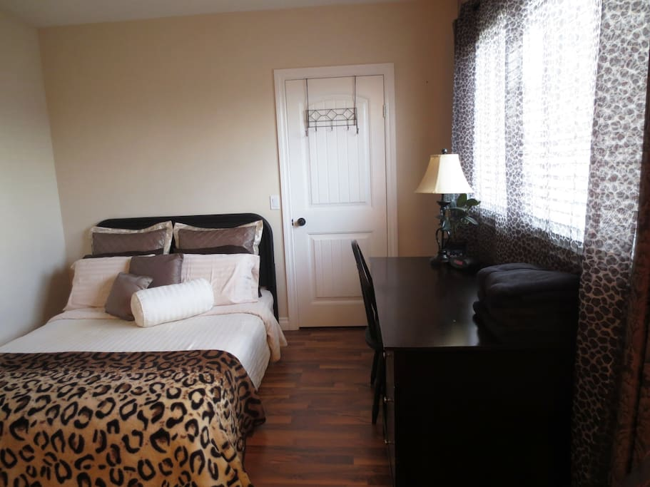 Your private leopard print themed room with queen size bed, desk, seating area for 3 or more, walk-in closet and private en-suite