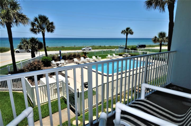 View of pool and ocean from second floor private patio off master bedroom.