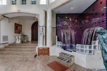 Entrance to the spa with our cold dip waterfall for cooling down after a visit to the sauna or hot tub