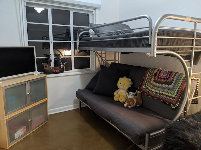 BEDROOM 2:  Kid Room or Den Chill Out Lounge * Bunk Bed with Twin Bed & Pull-Out Full Size Bed * Big Closet * Smart TV * Retro Super Nintendo Gaming System * Board Games * Toys * Adjustable Window Blinds   * Separate Blackout Window Shades