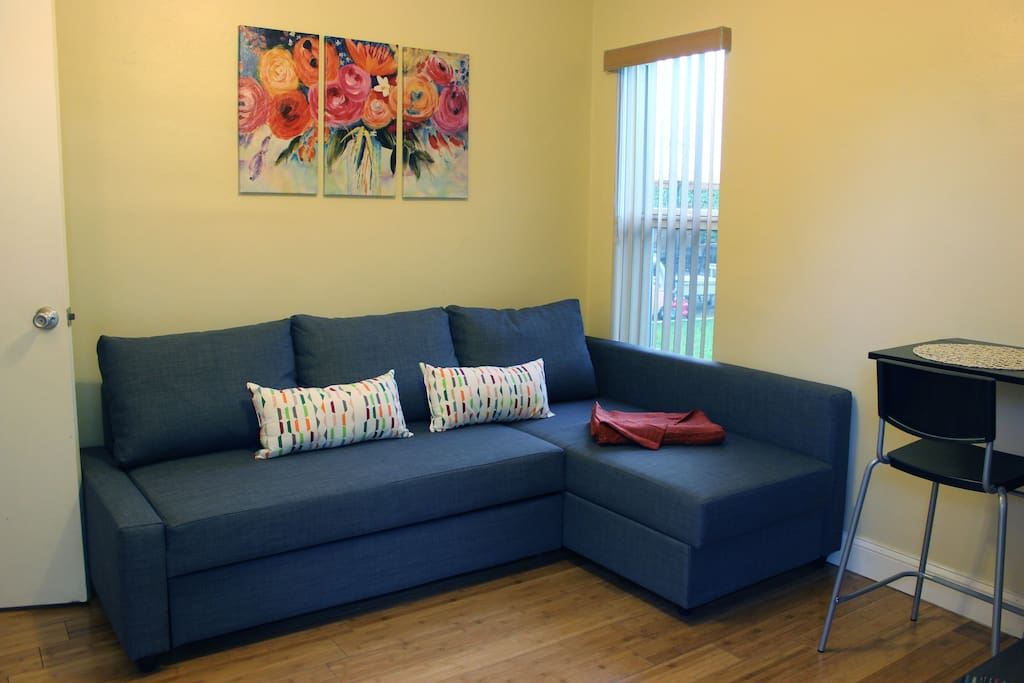 This is our cozy living room area. It includes a sofa bed that transforms the space into an extra bedroom.