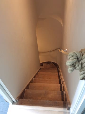 Oak staircase leads to penthouse