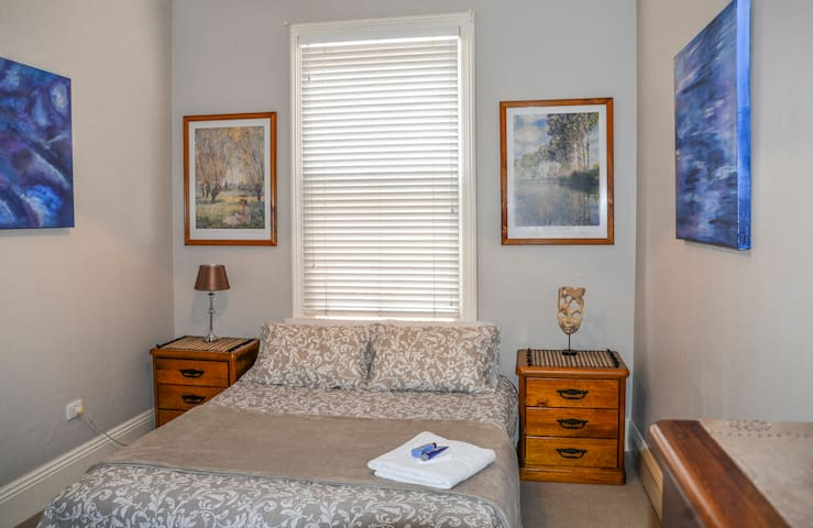 Bright, cosy, comfortable bedroom with everything you need. Ample storage within side tables, large triple robe & dresser. There is an electric blanket on the bed for cold weather, plus fresh towels, plenty of extra linen, extra pillows & blankets.
