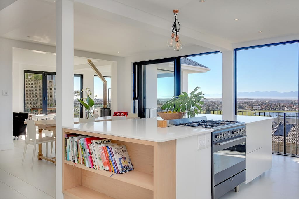 Open-plan kitchen with combination gas/electric Smeg Oven. Gorgeous island for entertaining.