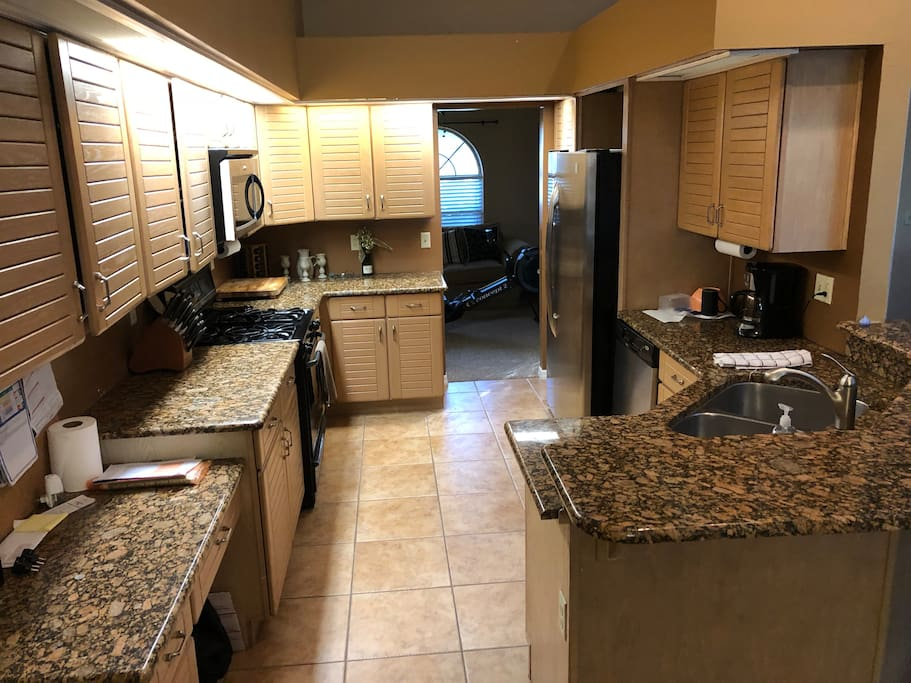 Kitchen with gas stove and full size fridge.