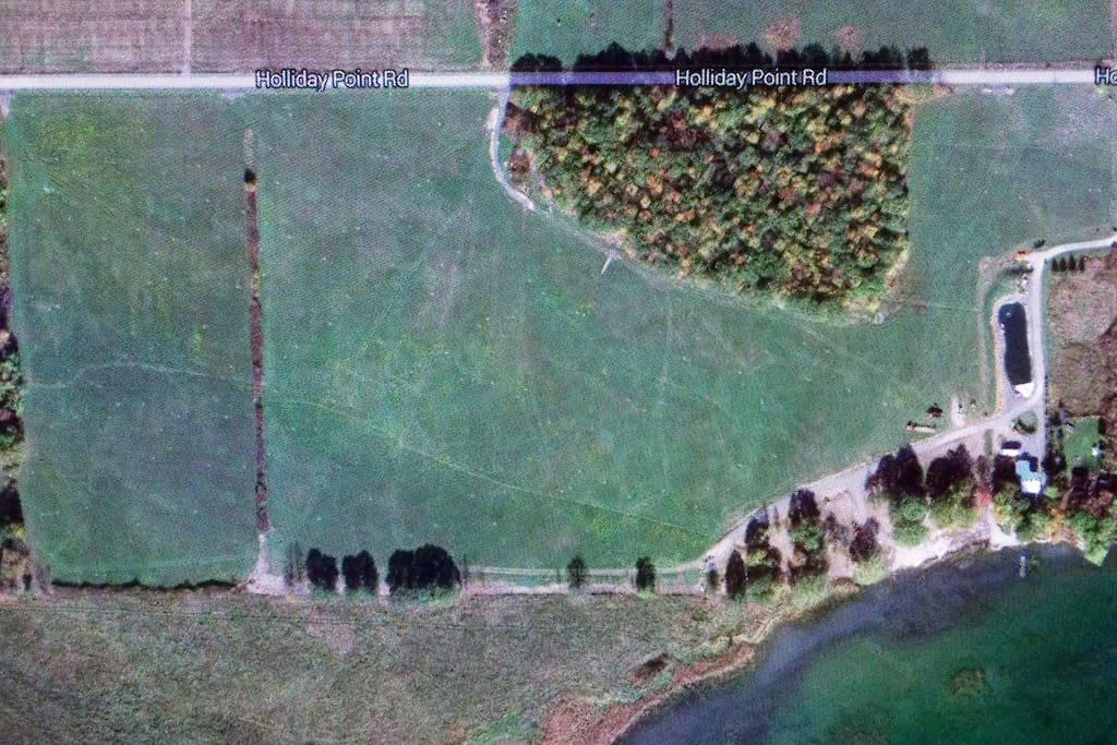 Google earth view of our farm shows the trout operation, our forest and the gravel farm road which leads to our rental unit.