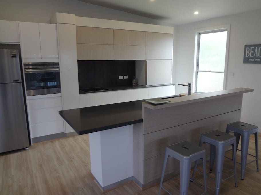 Designer Kitchen with electronic push button doors.