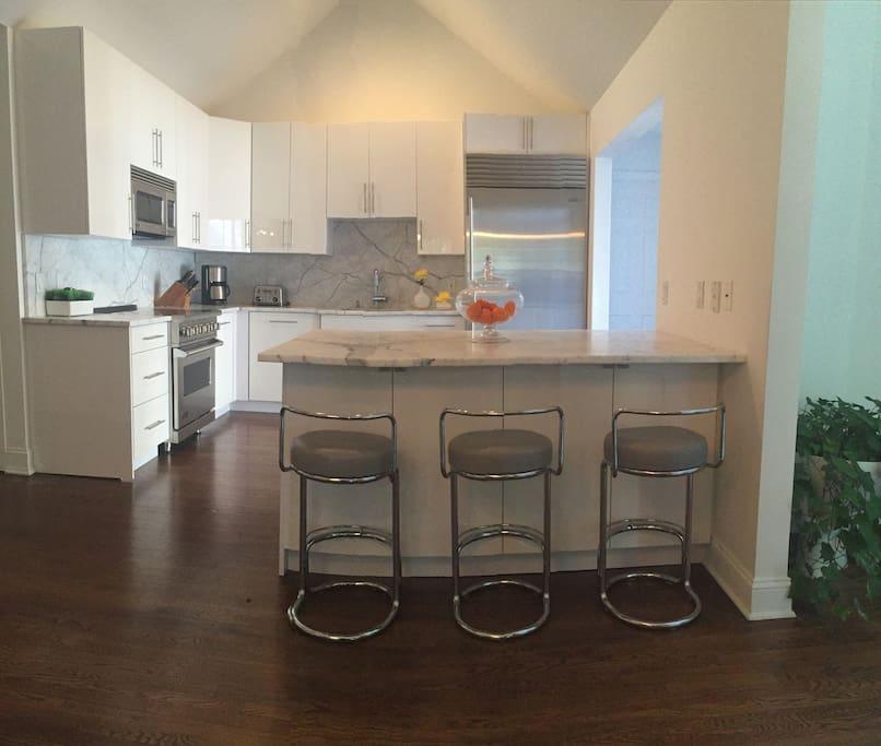 Chefs Kitchen with direct access to the patio, pool & deck