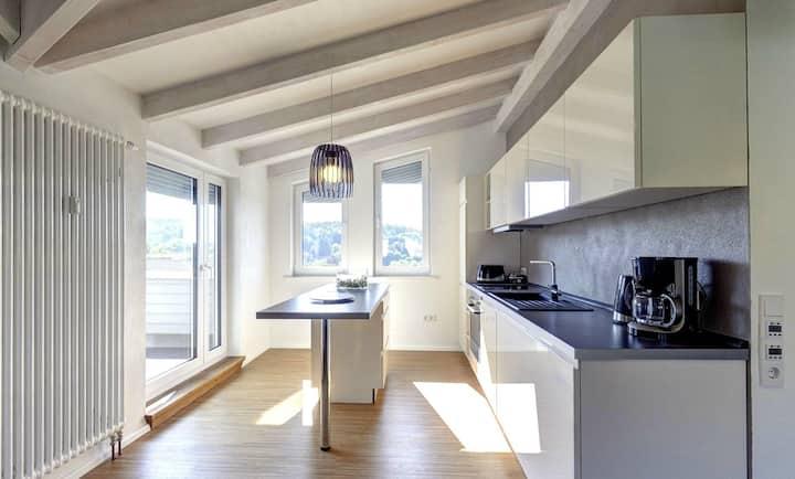 Moderne, helle 5* Wohnung mit Dachterrasse