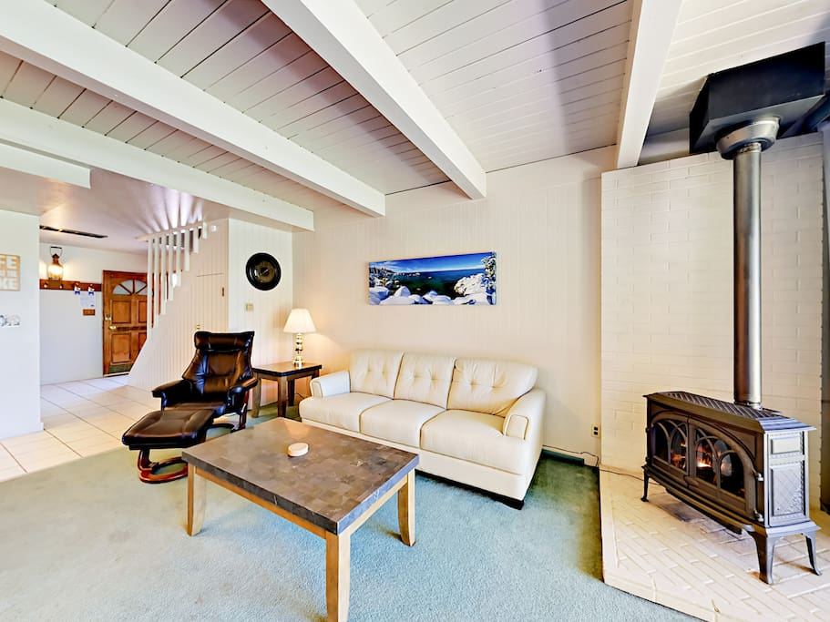 Unwind in the comfortable living room, outfitted with a queen-size sleeper sofa and a wood stove.