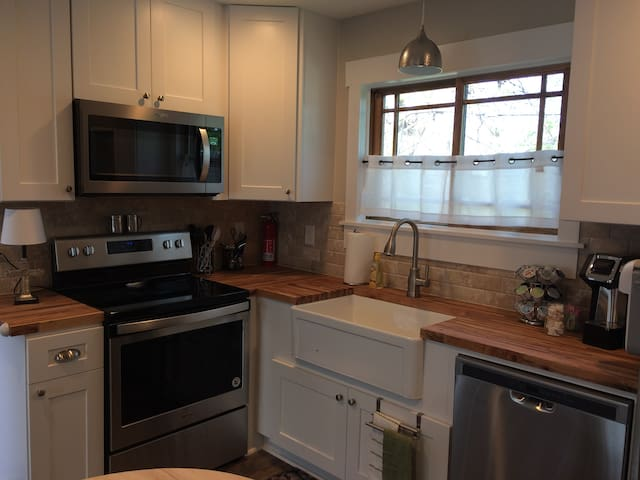 Full kitchen with dishwasher, microwave, and stove/oven. Comes fully stocked with plates, cups, backing pans, and silverware.