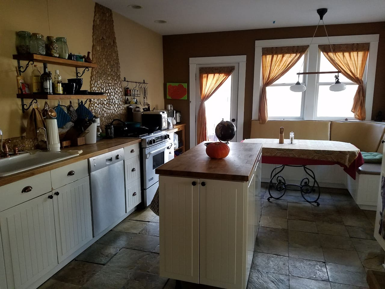 Big kitchen with all the standard amenities. Opens up to the deck and back yard.