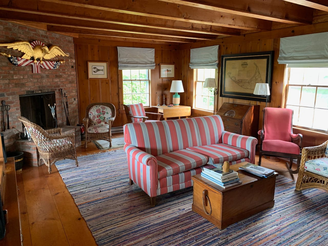 Carefully curated in the Authentic Nantucket style for you to relax with your friends and family. Living Room with fireplace, table for games, and a new, (huge) frame TV with Sonos.