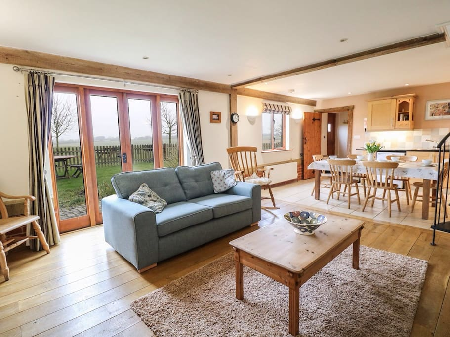 Spacious open plan living area with amazing views over farmland