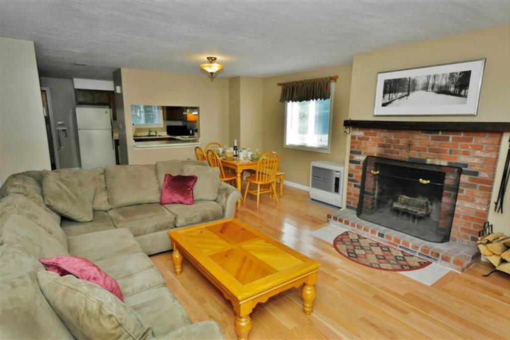 After a long day on the ski slopes or hiking trails, there's nothing better than cuddling up by the brick fireplace in the living area.