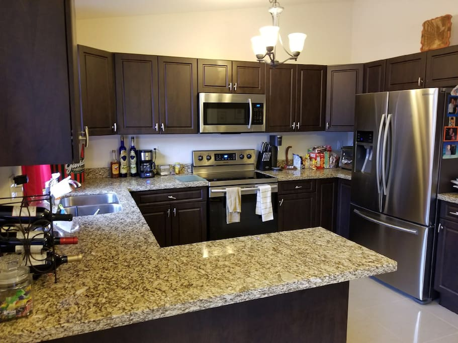 Kitchen with access to microwave oven and fridge.
