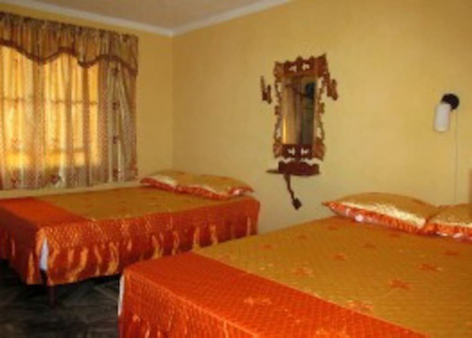1st Bedroom with 2 double bed and a full bathroom