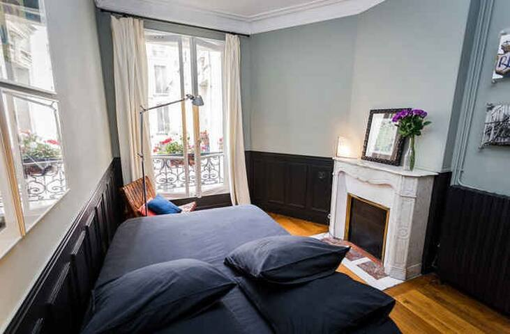 Bedroom with double bed and closets. It overlooks a private courtyard and not the street.