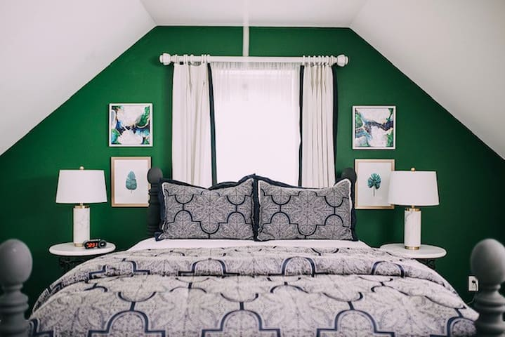 """Master suite with 4"""" memory foam topper on queen bed. Cotton bed linens and 4 plush pillows."""