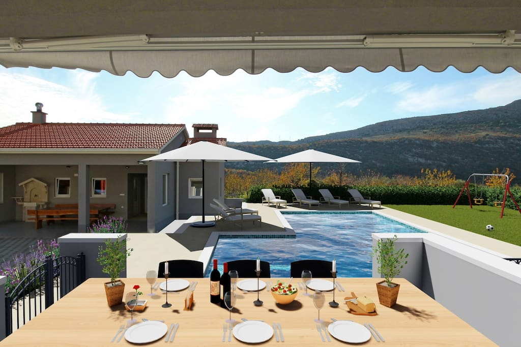 Terrace with view on the Pool area, Sommer Kitchen & Playground