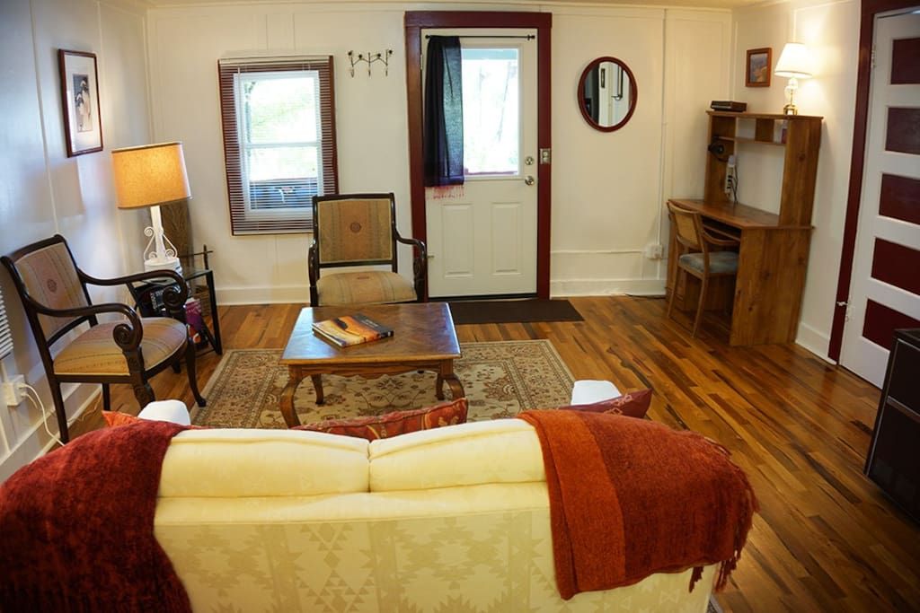 Spacious and open living room, beautiful hard wood floors throughout
