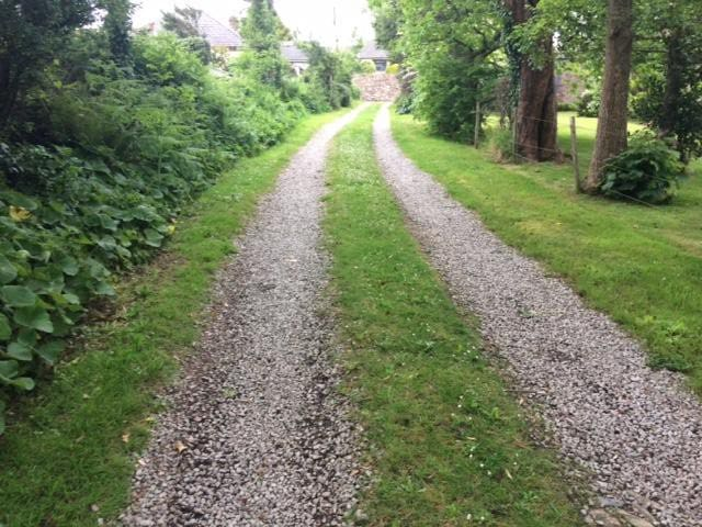 Long private drive way, but only yards from the village centre.