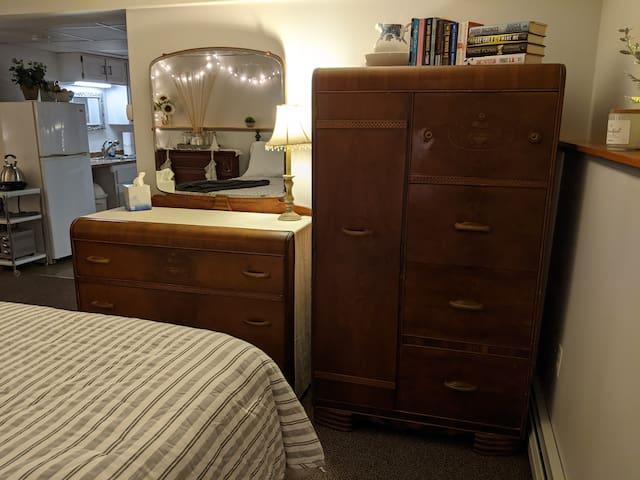 Cedar wardrobe and vanity bureau.